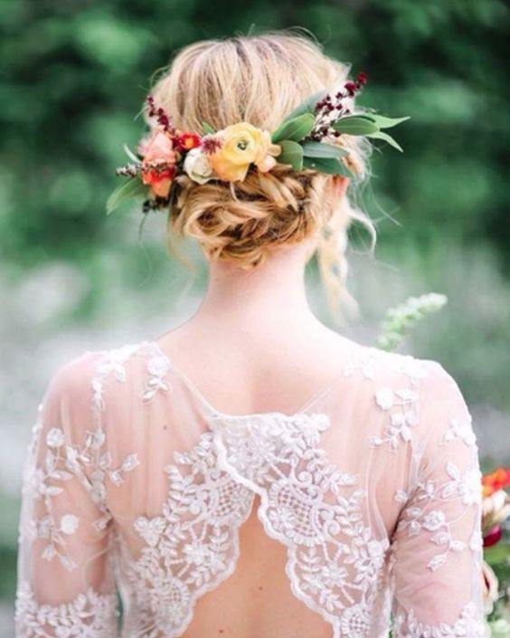 wedding hairstyle with bun and flowers